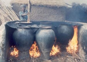 Brewing millet beer in Ghana