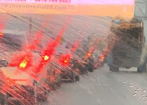 """Refracted taillights on a rainy day in a Lagos """"go slow"""""""